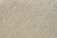 Ecru sandstone with grooves closeup. In sunny day Royalty Free Stock Photography