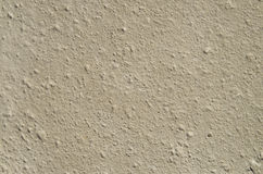 Ecru sandstone with grooves closeup. In sunny day Royalty Free Stock Photos