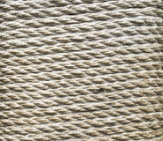Ecru thick rope wrapped around a pillar Royalty Free Stock Photography