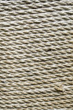 Ecru thick rope wrapped around  pillar Stock Images