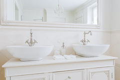 Ecru washbasins for big family Stock Image