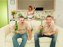Ecsited men watching tv Royalty Free Stock Photos