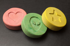 Ecstasy pills. Ecstasy tablets on black background royalty free stock photos