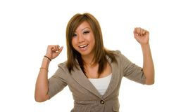Ecstatic Asian Business Woman. Young Asian woman in business suit raising hands in joy over accomplishment Royalty Free Stock Photo