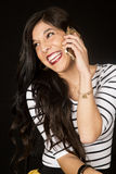 Ecstatic beautiful woman talking on her cell phone smiling Royalty Free Stock Images
