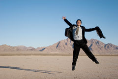 Ecstatic business man. Jumping in the air stock photography