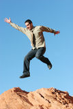 Ecstatic business man jumping Stock Image