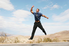 Ecstatic business man jumping in the air Royalty Free Stock Photo