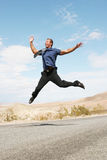 Ecstatic Business Man Jumping In The Air Stock Image
