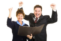 Ecstatic Business Partners. Male and female business partner ecstatic about their latest financial report. Isolated on white royalty free stock photos