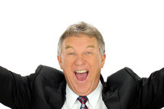 Ecstatic Businessman. Ecstatic middle aged businessman throws his arms into the air with delight royalty free stock photography