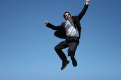 Ecstatic businessman. Jumping in the air royalty free stock photography