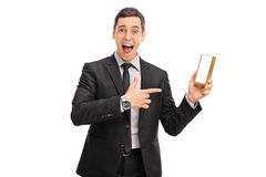 Ecstatic businessman holding a gold bar Royalty Free Stock Photo