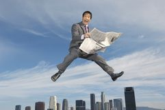 Ecstatic Businessman Holding A Newspaper Stock Photos