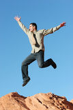 Ecstatic businessman jumping Stock Image
