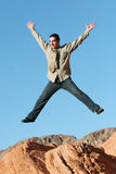 Ecstatic businessman jumping Royalty Free Stock Photography