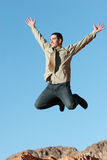 Ecstatic businessman jumping. In the air Royalty Free Stock Images