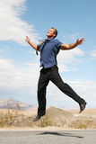 Ecstatic businessman jumping Royalty Free Stock Photos