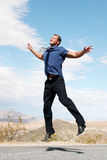 Ecstatic businessman jumping Royalty Free Stock Photos