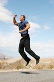 Ecstatic businessman jumping Stock Image