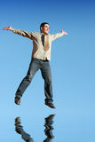 Ecstatic businessman jumping i Stock Photography