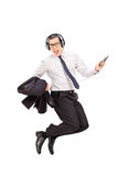 Ecstatic businessman listening music on his phone Royalty Free Stock Photo