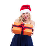 Ecstatic Christmas woman giving present Royalty Free Stock Images