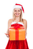Ecstatic Christmas woman with present. Beautiful cheerful Christmas woman holding present, isolated on white background Royalty Free Stock Photos