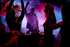 Ecstatic dj and dancers Royalty Free Stock Photography
