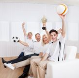 Ecstatic family celebrating a win Stock Photo