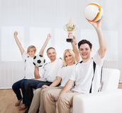 Ecstatic family celebrating a win Stock Photography