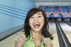 Ecstatic Female At Bowling Alley Stock Photo