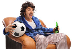 Ecstatic football fan watching a game on TV. And drinking beer isolated on white background Royalty Free Stock Photography