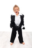 Ecstatic future businesswoman. Little girl trying her mother's clothes stock image