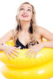 Ecstatic girl in swimsuit and rubber ring Royalty Free Stock Photos