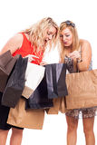 Ecstatic girls with shopping bags Stock Images