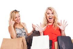 Ecstatic girls shopping Stock Image