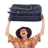 Ecstatic happy traveller with luggage Stock Image