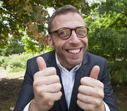 Ecstatic male businessman approving strategic leadership solutions outdoors Royalty Free Stock Photos