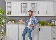 Ecstatic man in the kitchen. Concept royalty free stock image