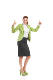 Ecstatic mid adult woman showing thumbs up. Royalty Free Stock Images