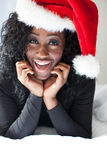 Ecstatic Pretty Woman as Santa in Black Stock Photography