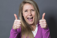 Ecstatic 20s woman with double thumbs up Royalty Free Stock Image