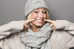 Ecstatic sexy 20s winter girl expressing joy with fake smile Royalty Free Stock Photography