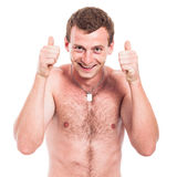 Ecstatic shirtless man thumbs up Stock Photos