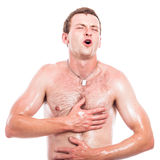 Ecstatic shirtless man Stock Photography