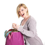 Ecstatic shopaholic with full carrier bag Royalty Free Stock Image