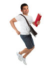 Ecstatic student jumping. A thrilled ecstatic university or college male student jumping into the air Royalty Free Stock Photos