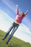 Ecstatic woman Stock Images