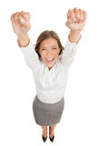 Ecstatic woman cheering and winning. Ecstatic happy woman cheering and winning. Humorous high angle perspective of a beautiful winner woman laughing and stock photo